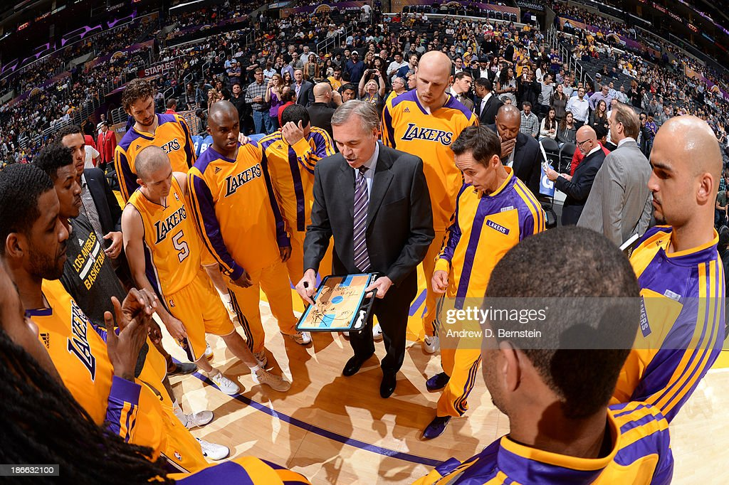 <a gi-track='captionPersonalityLinkClicked' href=/galleries/search?phrase=Mike+D%27Antoni&family=editorial&specificpeople=203175 ng-click='$event.stopPropagation()'>Mike D'Antoni</a>, Head Coach of the Los Angeles Lakers draws out a play before a game against the San Antonio Spurs on November 1, 2013 at STAPLES Center in Los Angeles, California.
