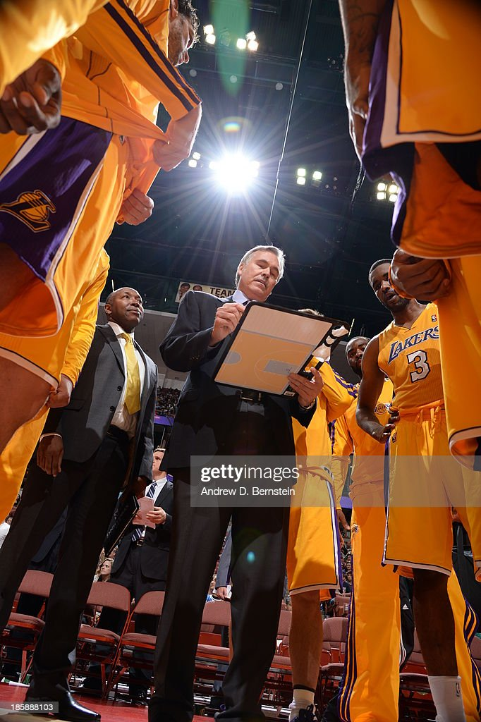 <a gi-track='captionPersonalityLinkClicked' href=/galleries/search?phrase=Mike+D%27Antoni&family=editorial&specificpeople=203175 ng-click='$event.stopPropagation()'>Mike D'Antoni</a>, Head Coach of the Los Angeles Lakers draws out a play for his team during a preseason game against the Utah Jazz at the Honda Center in Anaheim, California on October 25, 2013.