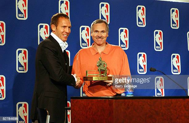 Mike D'Antoni head coach of the Phoenix Suns receives the Red Auerbach Trophy for being named the 20042005 NBA Coach of the Year by Bryan Colangelo...