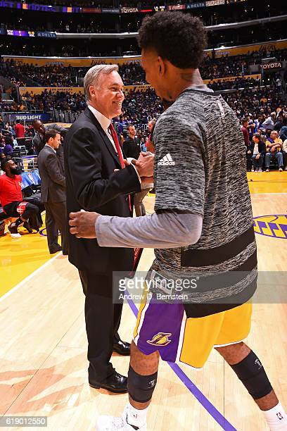 Mike D'Antoni of the Houston Rockets shakes hands with Nick Young of the Los Angeles Lakers before the game on October 26 2016 at STAPLES Center in...