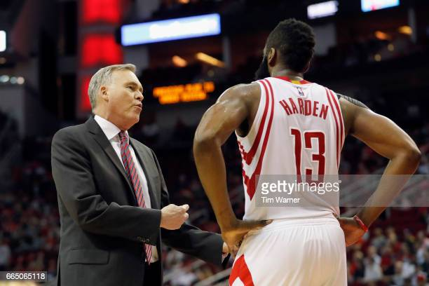 Mike D'Antoni of the Houston Rockets talks with James Harden of the Houston Rockets during a time out in the second half against the Denver Nuggets...