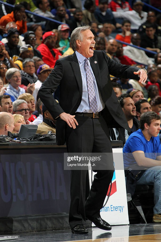 Mike D'Antoni of the Los Angeles Lakers calls a play against the New Orleans Pelicans on November 8, 2013 at the New Orleans Arena in New Orleans, Louisiana.