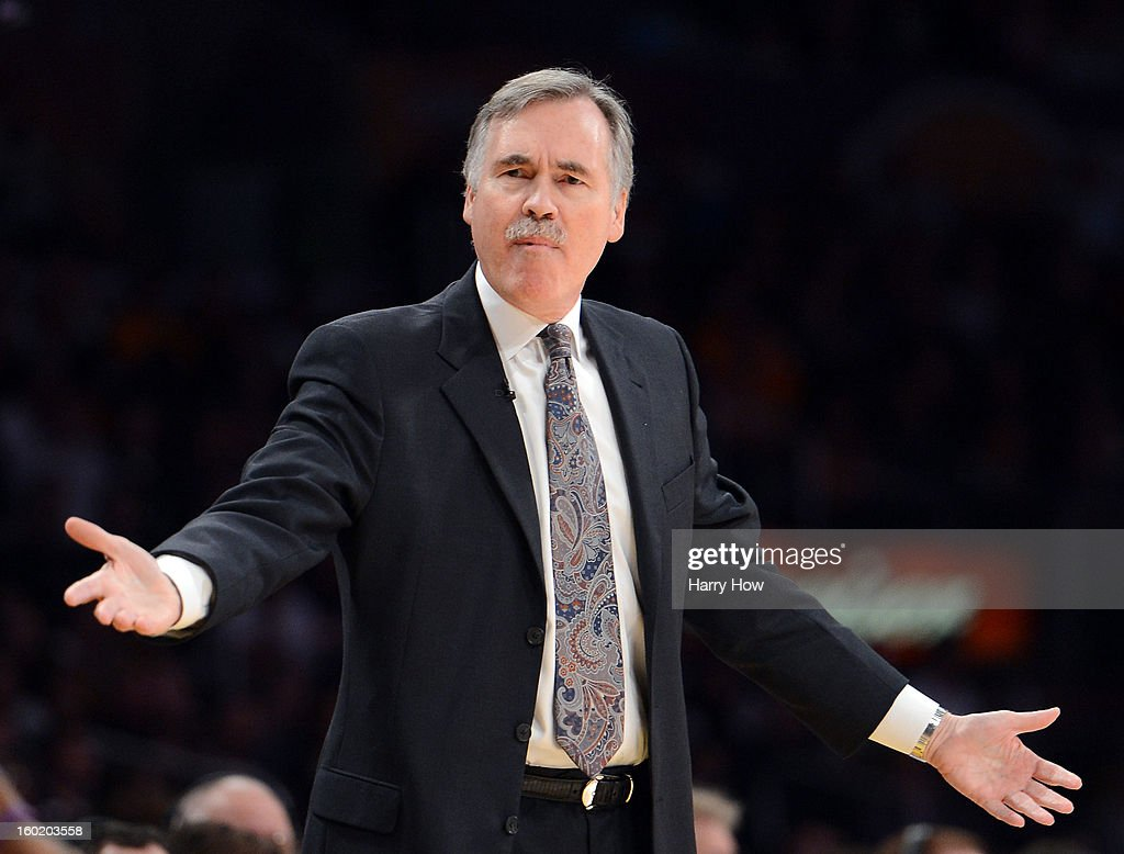 Mike D'Antoni of the Los Angeles Lakers calls for a goaltending violation during the game against the Oklahoma City Thunder at Staples Center on January 27, 2013 in Los Angeles, California.