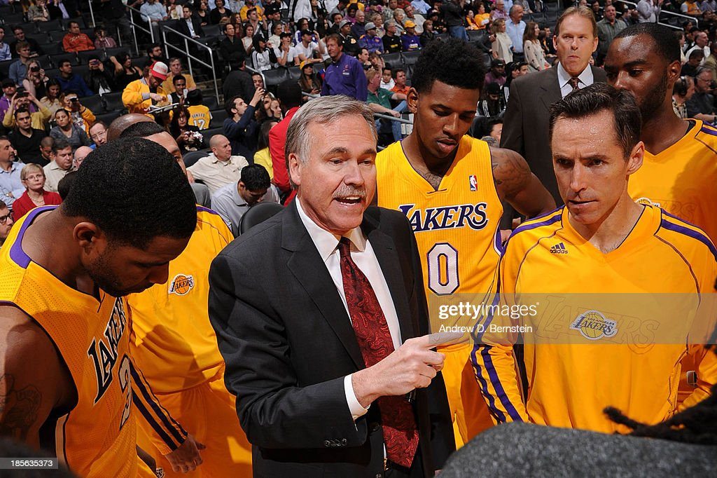 Mike D'Antoni of the Los Angeles Lakers directs his team before facing the Utah Jazz at Staples Center on October 22, 2013 in Los Angeles, California.