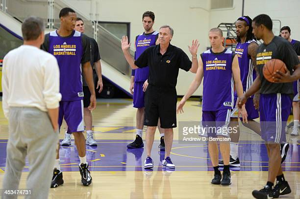 Mike D'Antoni of the Los Angeles Lakers explains a play during practice on December 3 2013 at Toyota Sports Center in El Segundo California NOTE TO...
