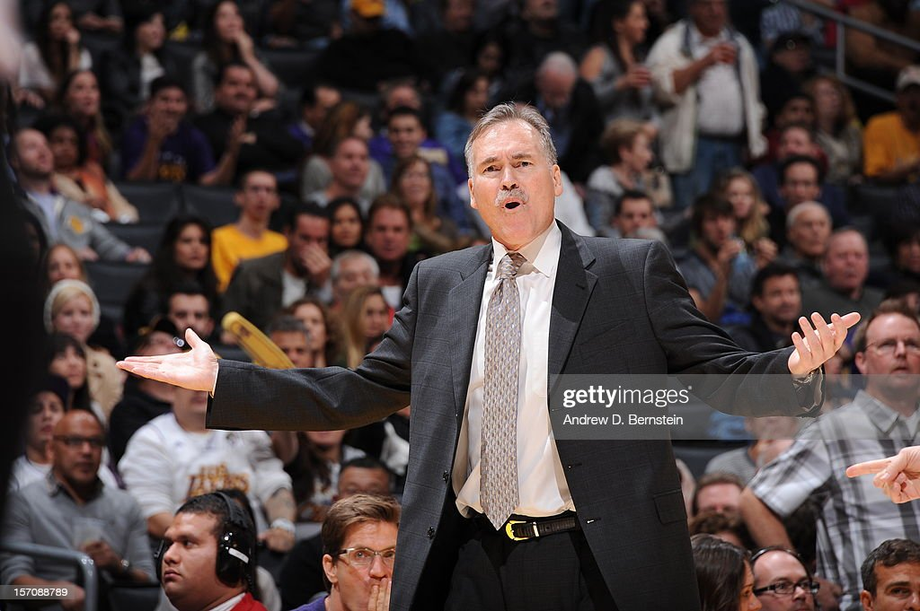 Mike D'Antoni of the Los Angeles Lakers questions a call during the game against the Indiana Pacers at Staples Center on November 27, 2012 in Los Angeles, California.
