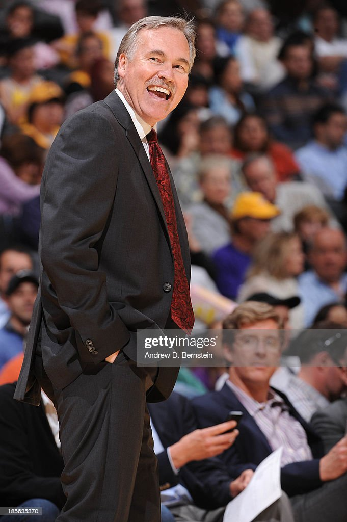 Mike D'Antoni of the Los Angeles Lakers smiles during a game against the Utah Jazz at Staples Center on October 22, 2013 in Los Angeles, California.