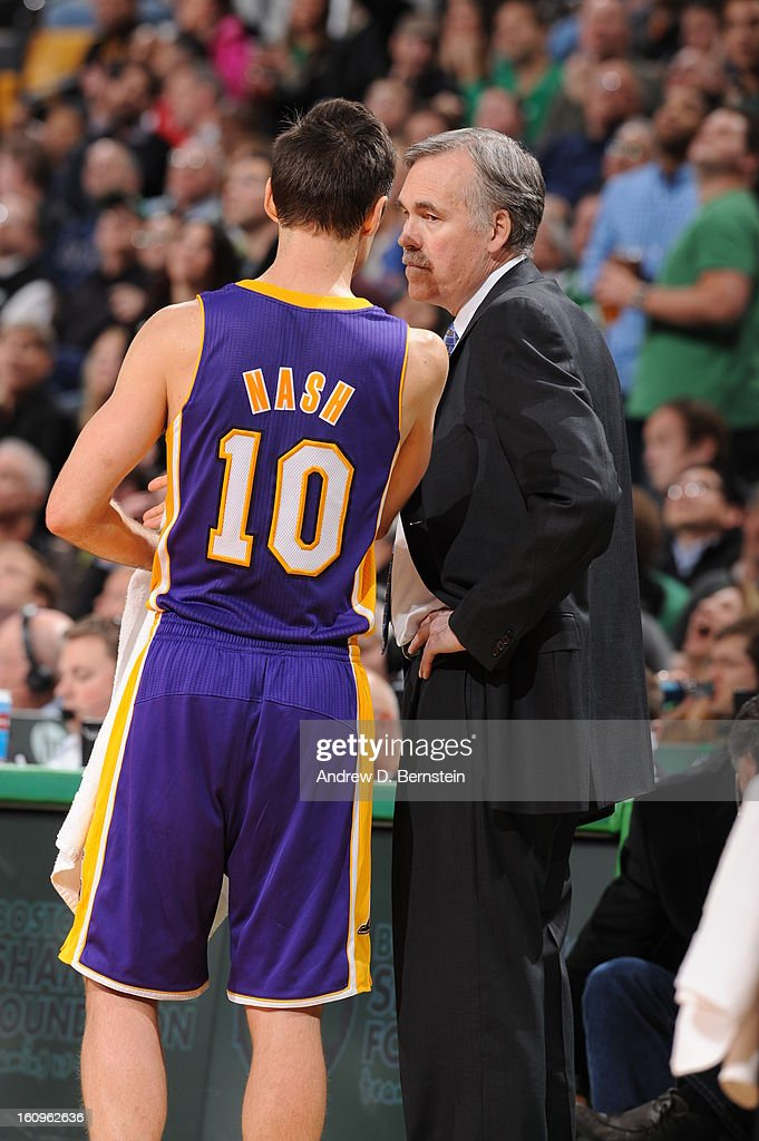 Mike D'Antoni of the Los Angeles Lakers speaks with Steve Nash #10 during the game against the Boston Celtics on February 7, 2013 at the TD Garden in Boston, Massachusetts.