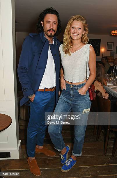 Mike Dargas and Toni Garrn attend a private dinner hosted by Dylan Jones and JeanDavid Malat to celebrate artist Mike Dargas at Soho House on July 5...