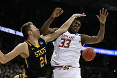 Mike Daum of the South Dakota State Jackrabbits fouls Diamond Stone of the Maryland Terrapins in the second half during the first round of the 2016...