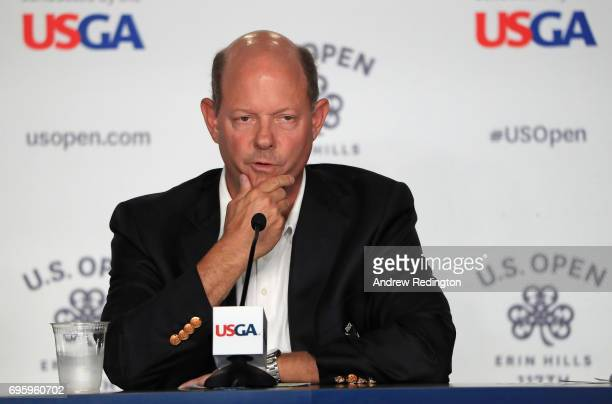Mike Davis Executive Director of the USGA speaks to the media during a practice round prior to the 2017 US Open at Erin Hills on June 14 2017 in...
