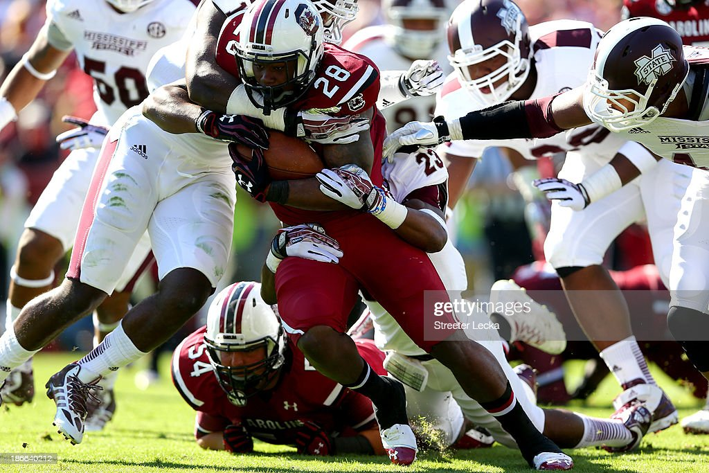 Mike Davis #28 of the South Carolina Gamecocks runs with the ball against the Mississippi State Bulldogs during their game at Williams-Brice Stadium on November 2, 2013 in Columbia, South Carolina.