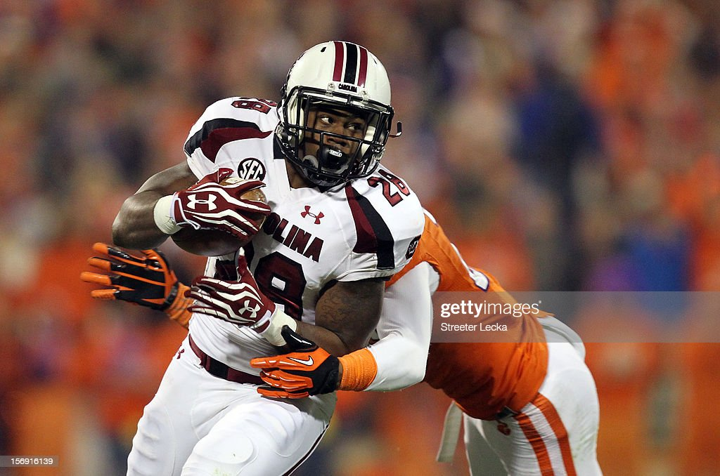 Mike Davis #28 of the South Carolina Gamecocks runs with the ball during their game against the Clemson Tigers at Memorial Stadium on November 24, 2012 in Clemson, South Carolina.