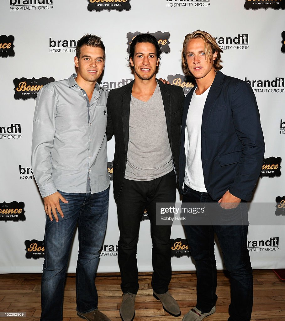 Mike Del Zotto, Carl Hagelin and Brett Valliquette attends the 1 year anniversary party at Bounce Sporting Club on September 19, 2012 in New York City.