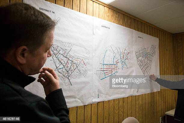 Mike Dennehy interim commissioner of the Boston Public Works Department known as the 'snow czar' looks at maps of different parts of the city at the...