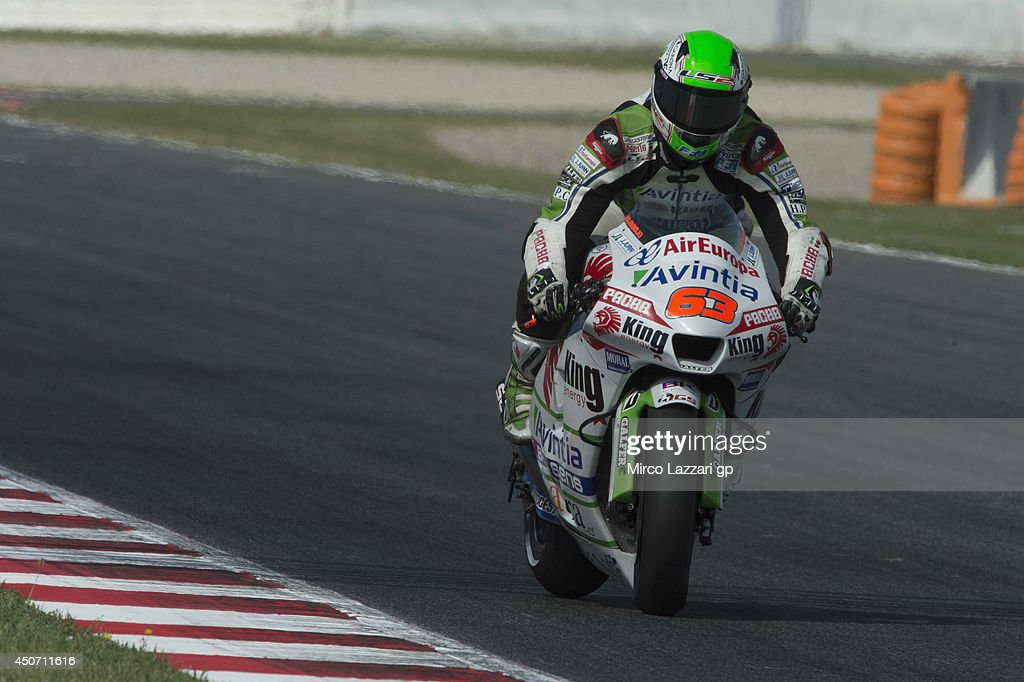 <a gi-track='captionPersonalityLinkClicked' href=/galleries/search?phrase=Mike+Di+Meglio&family=editorial&specificpeople=2166936 ng-click='$event.stopPropagation()'>Mike Di Meglio</a> of France and Avintia Blusens heads down a straight during the MotoGp Tests In Montmelo at Circuit de Catalunya on June 16, 2014 in Montmelo, Spain.