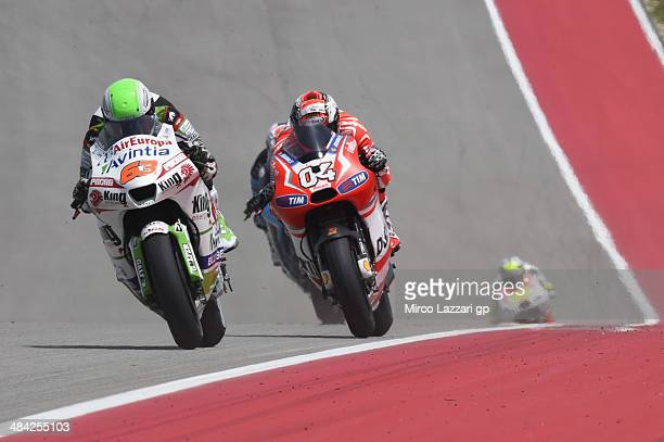 Mike Di Meglio of France and Avintia Blusens leads Andrea Dovizioso of Italy and Ducati Team during the MotoGp Red Bull US Grand Prix of The Americas...