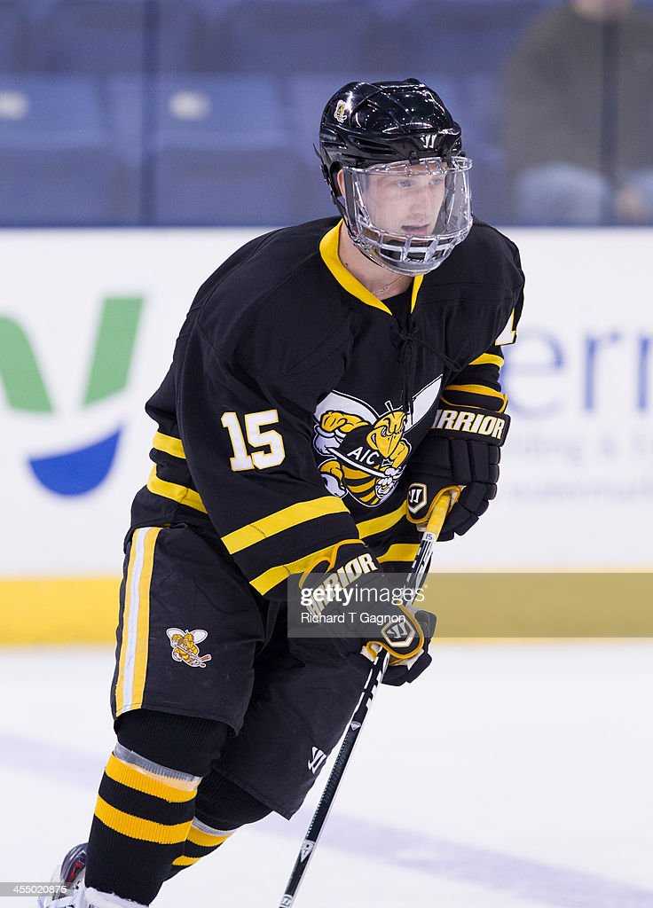 Mike Dietrich #15 of the American International College Yellow Jackets warms-up before NCAA hockey action against the Massachusetts Lowell River Hawks at the Tsongas Center on December 3, 2013 in Lowell, Massachusetts.