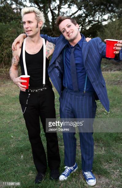 Mike Dirnt and Tre Cool of Green Day during Voodoo Music Experience 2004 Day One Backstage at City Park in New Orleans Louisiana United States