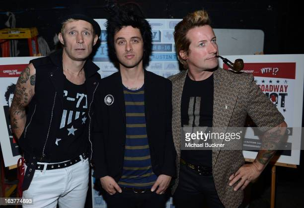 Mike Dirnt Billie Joe Armstrong and Tre Cool of Green Day pose backstage for a picture before the World Premiere of 'Broadway Idiot' during the 2013...