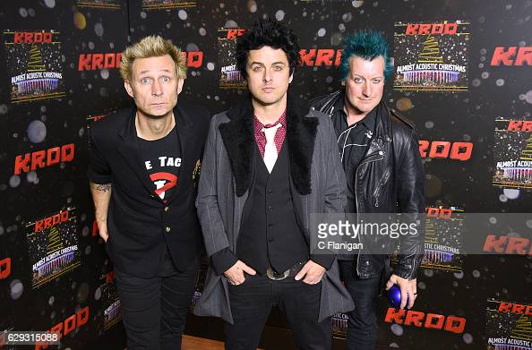 Mike Dirnt Billie Joe Armstrong and Tre Cool of the band Green Day attend 1067 KROQ Almost Acoustic Christmas 2016 Night 2 at The Forum on December...