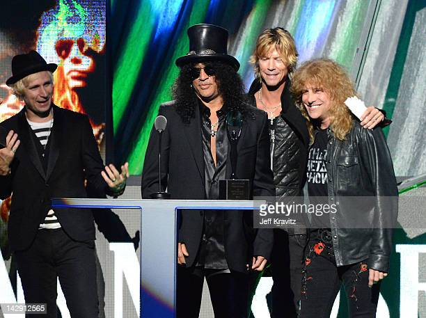 Mike Dirnt of Green Day and Inductees Slash Duff McKagan and Steven Adler of Guns N' Roses on stage at the 27th Annual Rock And Roll Hall Of Fame...