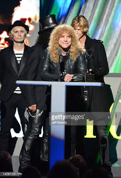Mike Dirnt of Green Day and Inductees Slash Steven Adler and Duff McKagan of Guns N' Roses performs on stage at the 27th Annual Rock And Roll Hall Of...