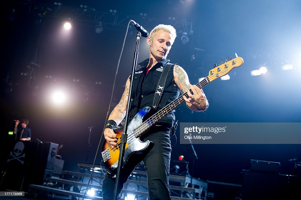 <a gi-track='captionPersonalityLinkClicked' href=/galleries/search?phrase=Mike+Dirnt&family=editorial&specificpeople=204154 ng-click='$event.stopPropagation()'>Mike Dirnt</a> of Green Day performs onstage at Brixton Academy on August 21, 2013 in London, England.