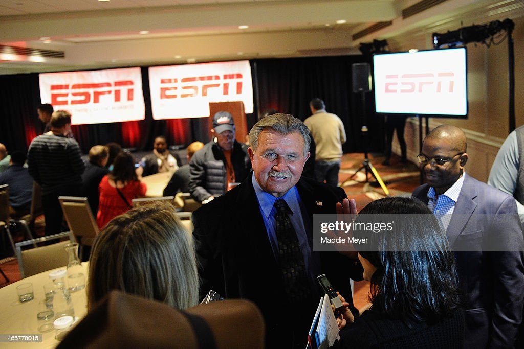 Mike Ditka, former NFL player and coach, and current ESPN analyst, talks with reporters during the ESPN media availablility in the Empire West Ballroom, at Super Bowl XLVIII Media Center at the Sheraton New York Times Square on January 28, 2014 in New York, New York.
