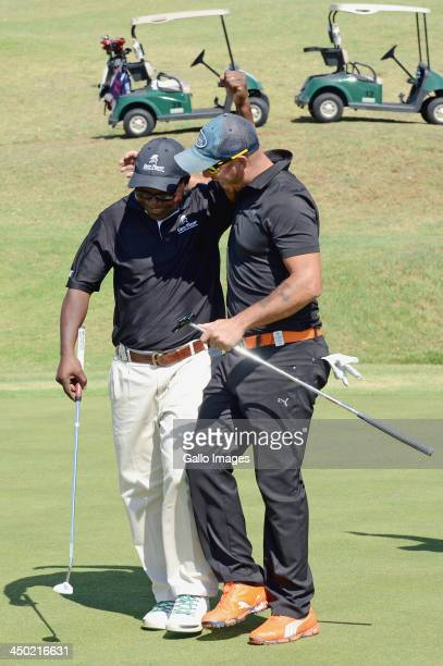 Mike Dladla is congratulated by teammate Herschelle Gibbs after sinking the winning putt during Round 2 of the Gary Player Invitational presented by...