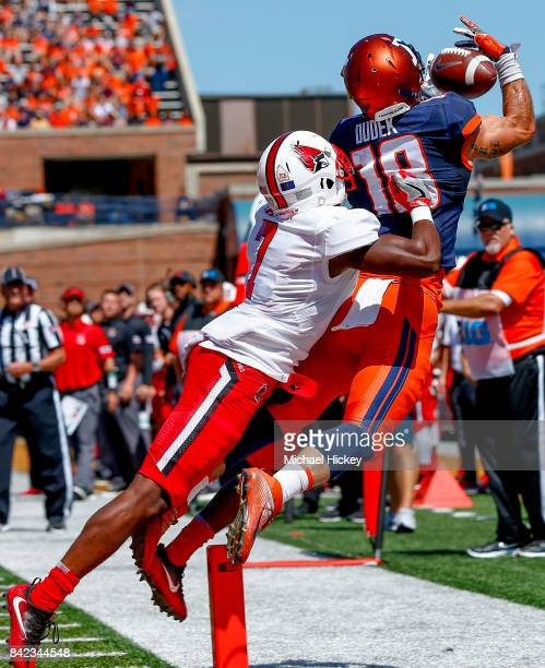 Mike Dudek of the Illinois Fighting Illini goes up for the pass as Marc Walton of the Ball State Cardinals defends at Memorial Stadium on September 2...