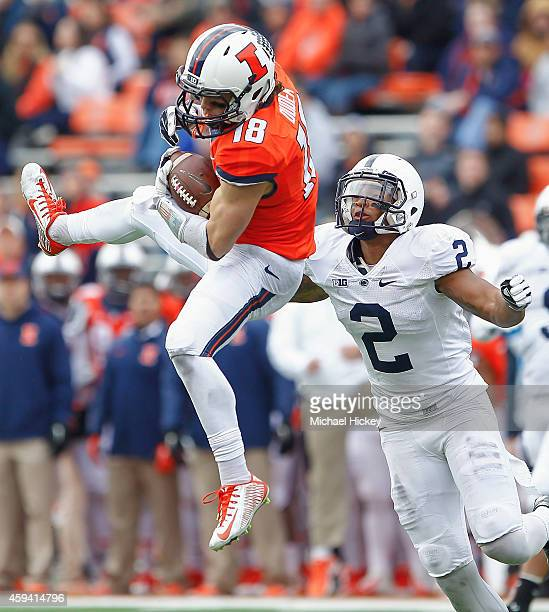 Mike Dudek of the Illinois Fighting Illini goes up to make a catch setting up a late second quarter touchdown as Marcus Allen of the Penn State...
