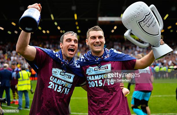 Mike Duff of Burnley and Sam Vokes of Burnley celebrates winning the Championship after the Sky Bet Championship between Charlton Athletic and...