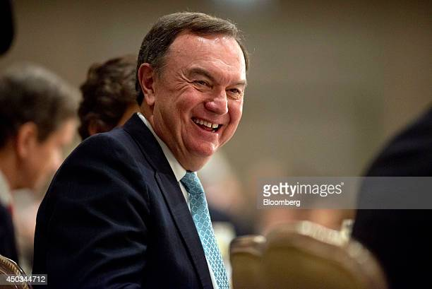 Mike Duke chairman of the WalMart Stores Inc executive committee and chief executive officer of WalMart Stores from 2009 to 2014 smiles at the start...