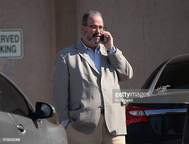 Mike Dunafon owners of PT's Showclub talks on the phone after Denver police clear the scene outside of the club in southwest Denver after earlier...