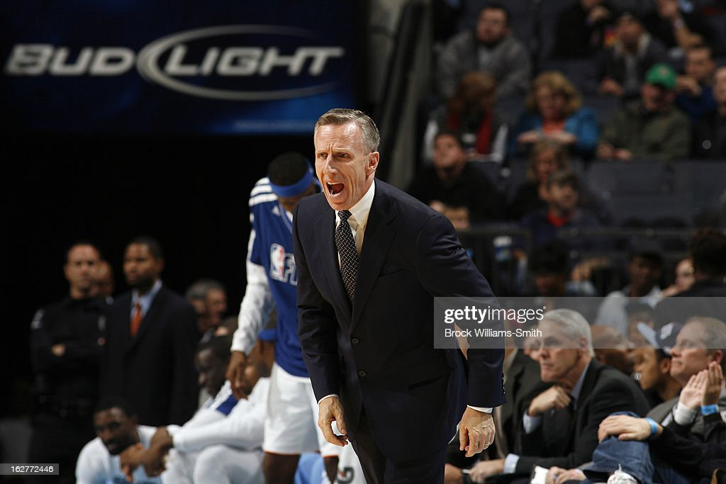 Mike Dunlap of the Charlotte Bobcats calls plays from the bench during the game against the Minnesota Timberwolves at the Time Warner Cable Arena on January 26, 2013 in Charlotte, North Carolina.
