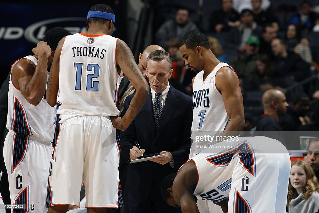 Mike Dunlap of the Charlotte Bobcats draws up plays during a time stoppage during the game against the Minnesota Timberwolves at the Time Warner Cable Arena on January 26, 2013 in Charlotte, North Carolina.