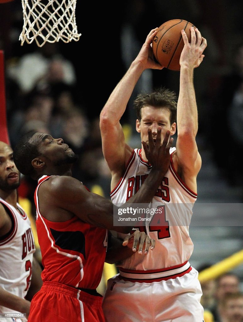 Mike Dunleavey #34 of the Chicago Bulls is hit in the face as he rebounds by Paul Millsap #4 of the Atlanta Hawks at the United Center on February 11, 2014 in Chicago, Illinois. The Bulls defeated the Hawks 100-85.