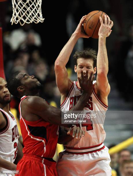 Mike Dunleavey of the Chicago Bulls is hit in the face as he rebounds by Paul Millsap of the Atlanta Hawks at the United Center on February 11 2014...