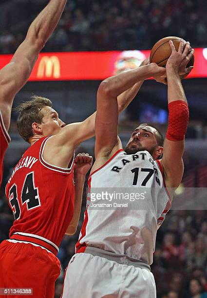 Mike Dunleavy of the Chicago Bulls blocks a shot by Jonas Valanciunas of the Toronto Raptors at the United Center on February 19 2016 in Chicago...