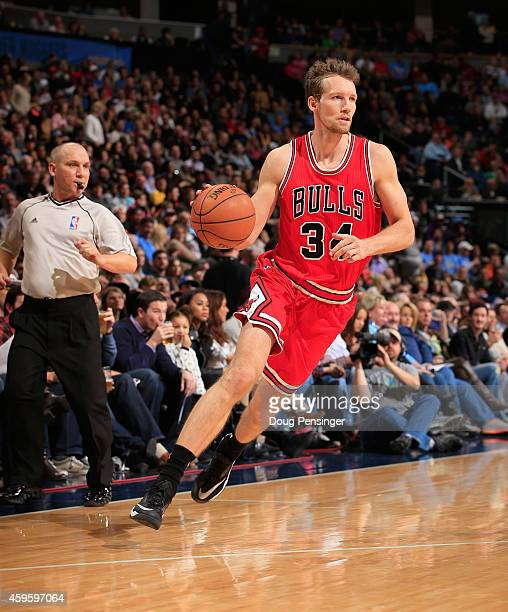 Mike Dunleavy of the Chicago Bulls controls the ball against the Denver Nuggets at Pepsi Center on November 25 2014 in Denver Colorado The Nuggets...