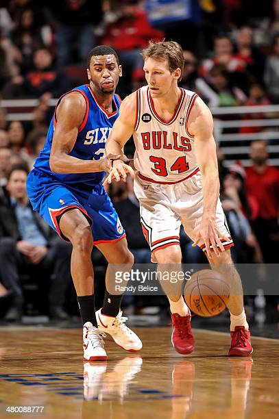 Mike Dunleavy of the Chicago Bulls drives against Hollis Thompson of the Philadelphia 76ers on March 22 2013 at the United Center in Chicago Illinois...