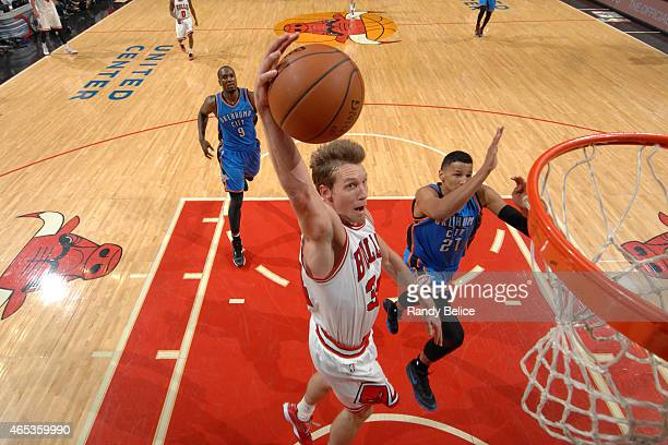 Mike Dunleavy of the Chicago Bulls drives to the basket against the Oklahoma City Thunder on March 5 2015 at the United Center in Chicago Illinois...