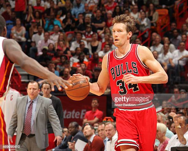 Mike Dunleavy of the Chicago Bulls drives to the basket against the Miami Heat during the game on April 9 2015 at AmericanAirlines Arena in Miami...