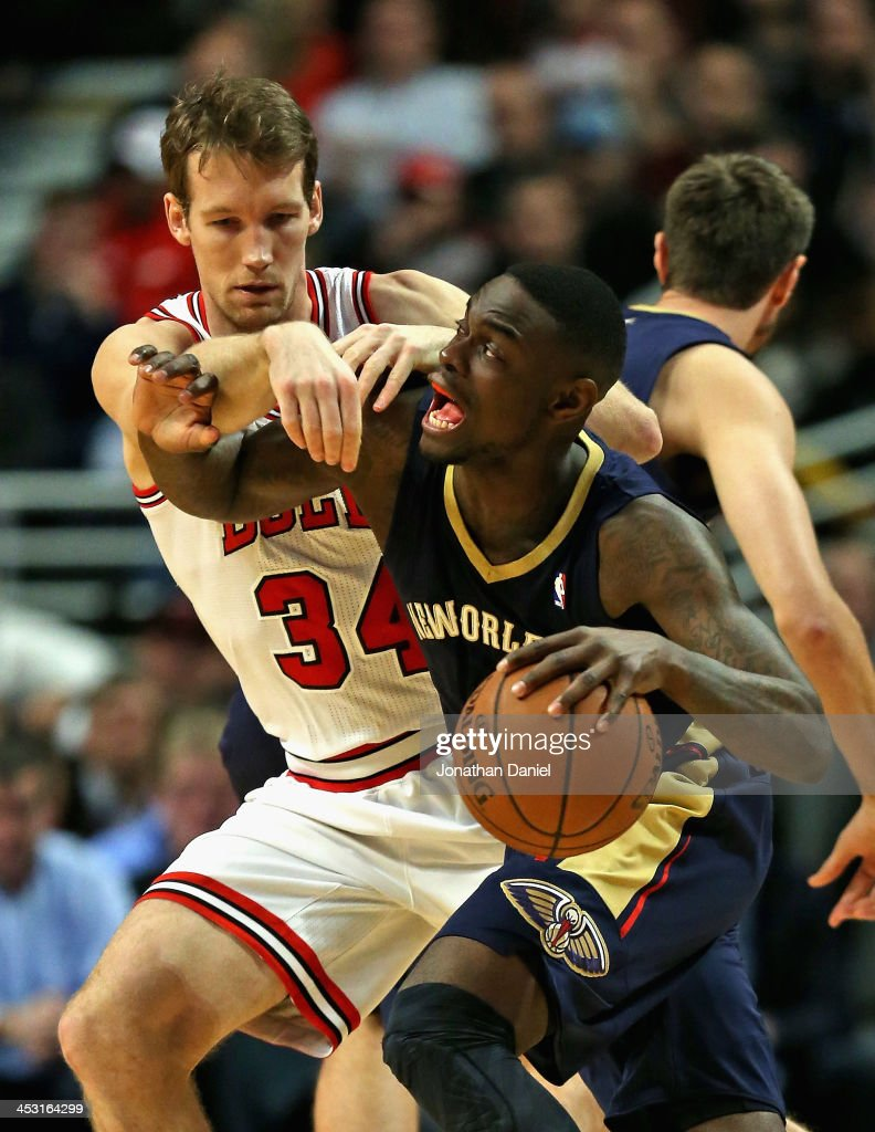 Mike Dunleavy #34 of the Chicago Bulls fouls <a gi-track='captionPersonalityLinkClicked' href=/galleries/search?phrase=Anthony+Morrow&family=editorial&specificpeople=814354 ng-click='$event.stopPropagation()'>Anthony Morrow</a> #3 of the New Orleans Pelicans at the United Center on December 2, 2013 in Chicago, Illinois.