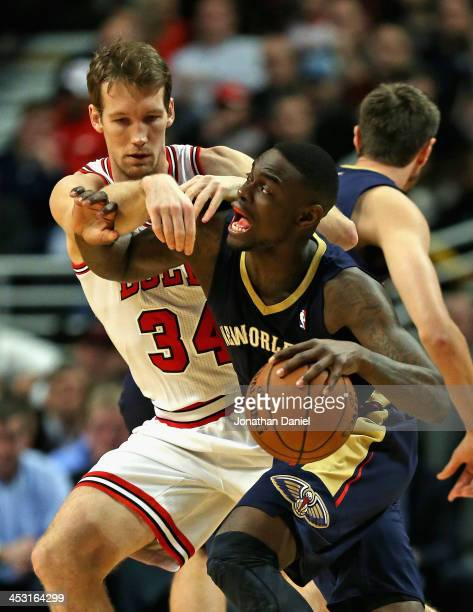 Mike Dunleavy of the Chicago Bulls fouls Anthony Morrow of the New Orleans Pelicans at the United Center on December 2 2013 in Chicago Illinois NOTE...