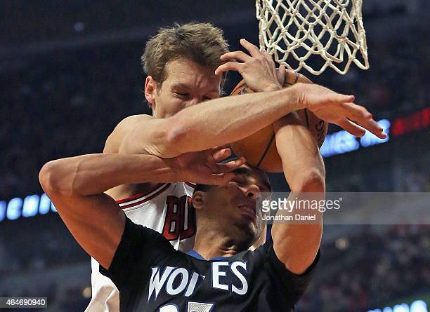 Mike Dunleavy of the Chicago Bulls fouls Kevin Martin of the Minnesota Timberwolves at the United Center on February 27 2015 in Chicago Illinois NOTE...