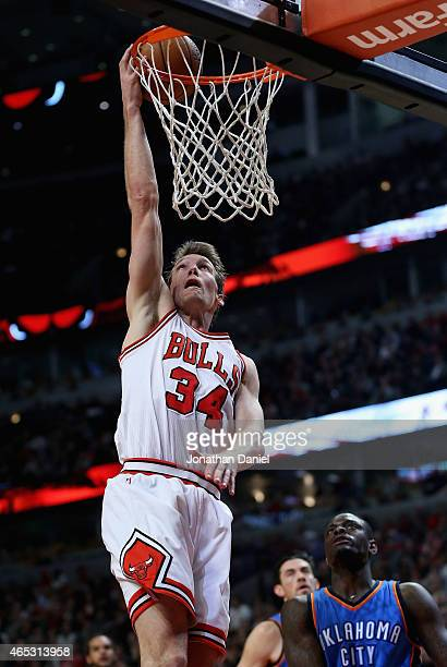Mike Dunleavy of the Chicago Bulls goes up for a shot past Anthony Morrow of the Oklahoma City Thunder at the United Center on March 5 2015 in...