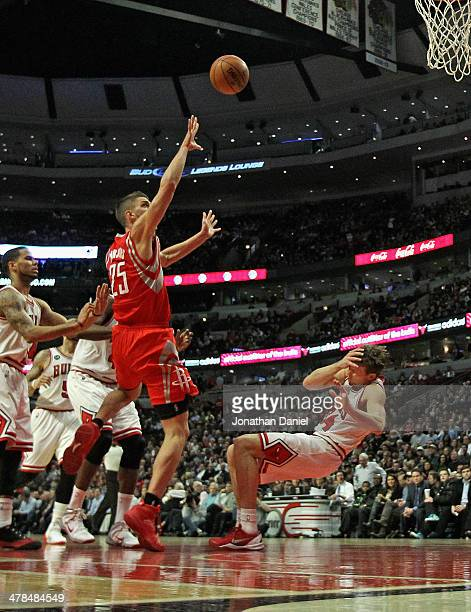 Mike Dunleavy of the Chicago Bulls grabs his face and hits the floor after being fouled by Chandler Parsons of the Houston Rockets at the United...