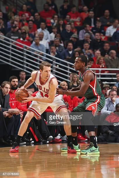 Mike Dunleavy of the Chicago Bulls handles the ball against Khris Middleton of the Milwaukee Bucks in Game Five of the Eastern Conference...